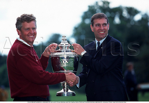 COLIN MONTGOMERIE, celebrates his win with Prince Andrew and the trophy, Volvo PGA Golf Championships, Wentworth, 000529. Photo: Glyn Kirk/Action Plus...2000.cup .winner.royalty.golfer golfers.portrait.celebration.celebrate.celebrating.celebrations.joy.