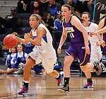 SIOUX FALLS, SD - MARCH 10:  Haley Seibert #10 of IPFW dribbles up the court trailed by Michelle Maher #14 of Western Illinois during their game at 2013 Summit League Basketball Championships Sunday at the Sioux Falls Arena. (Photo by Dick Carlson/Inertia)