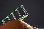 Computer memory chip on red sand