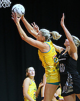 Australia's Cath Cox, left, reaches for the ball ahead of New Zealand's Casey Williams in the New World Quad series netball match, Claudelands Arena, Hamilton, New Zealand, Thursday, November 01, 2012. Credit:NINZ / Dianne Manson.