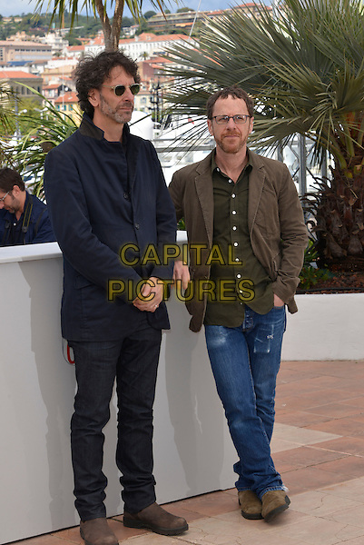 Joel Coen and Ethan Coen.'Inside Llewyn Davis' film photocall at the 66th  Cannes Film Festival, Cannes, France, 19th May 2013..full length directors brothers brother siblings family glasses jeans green shirt jacket brown sunglasses  .CAP/PL.©Phil Loftus/Capital Pictures.