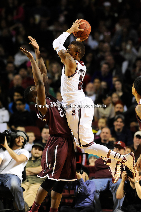 January 26, 2014 - Amherst, Massachusetts, U.S. -Massachusetts Minutemen guard Derrick Gordon (2) flies into Fordham Rams guard Bryan Smith (24) during the NCAA basketball game between the Fordham Rams and the Massachusetts Minutemen held at  the Mullin Center in Amherst Massachusetts. Final score Massachusetts 90 Fordham 52  Eric Canha/CSM