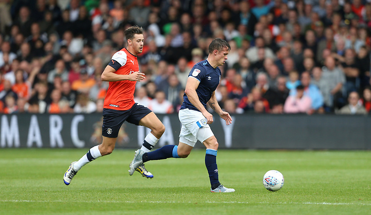 Huddersfield Town's Jonathan Hogg and Luton Town's Harry Cornick<br /> <br /> Photographer Rob Newell/CameraSport<br /> <br /> The EFL Sky Bet Championship - Luton Town v Huddersfield Town - Saturday 31 August 2019 - Kenilworth Stadium - Luton<br /> <br /> World Copyright © 2019 CameraSport. All rights reserved. 43 Linden Ave. Countesthorpe. Leicester. England. LE8 5PG - Tel: +44 (0) 116 277 4147 - admin@camerasport.com - www.camerasport.com