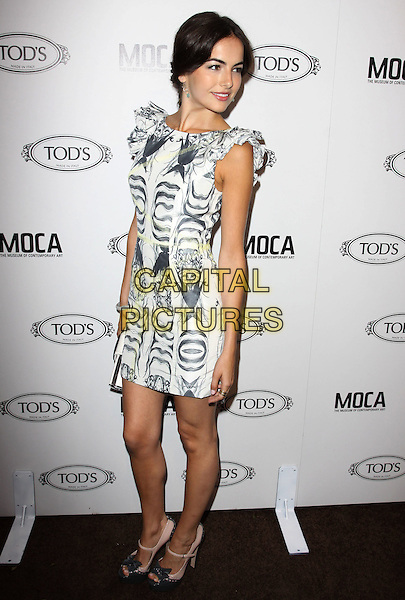 CAMILLA BELLE.Tod's Beverly Hills boutique Grand Opening held At Tod's Boutique, Beverly Hills, California, USA. .April 15th, 2010 .full length sleeveless black white print dress grey gray ruffle sleeve bracelet clutch bag platform shoes bows beige open peep toe mary janes .CAP/ADM/KB.©Kevan Brooks/AdMedia/Capital Pictures.