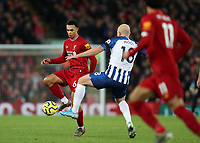 30th November 2019; Anfield, Liverpool, Merseyside, England; English Premier League Football, Liverpool versus Brighton and Hove Albion; Trent Alexander-Arnold of Liverpoolcontrols the ball under pressure from Aaron Mooy of Brighton and Hove Albion  - Strictly Editorial Use Only. No use with unauthorized audio, video, data, fixture lists, club/league logos or 'live' services. Online in-match use limited to 120 images, no video emulation. No use in betting, games or single club/league/player publications