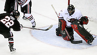UNO goalie Mike Taffe makes a glove save on a point-blank shot by St. Cloud State's David Eddy during the second period. UNO rallied from a 3-0 deficit to beat St. Cloud State 4-3 Saturday night at Qwest Center Omaha.  (Photo by Michelle Bishop)