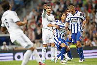 ATENCAO EDITOR IMAGENS EMBAGADAS PARA VEICULOS INTERNACIONAIS - <br /> MADRI, ESPANHA, 30 SETEMBRO 2012 - CAMP. ESPANHOL - REAL MADRID X DEPORTIVO LA CORUNA - Cristino Ronaldo (C) jogador do Real Madrid, durante lance de partida contra Deportivo La Coruna pela sexta rodada do Campeonato Espanhol no Estadio Santiago Bernabeu em Madri capital da Espanha, neste domingo, 30. (FOTO: ALFAQUI / BRAZIL PHOTO PRESS).