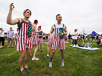 BALTIMORE, MD - MAY 20: A group of men wearing patriotic themed overalls take in the festivities of the infield on Preakness Stakes Day at Pimlico Race Course on May 20, 2017 in Baltimore, Maryland.(Photo by Scott Serio/Eclipse Sportswire/Getty Images)