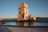 The Torre de Belem or Belem Tower, built in the 16th century by Francisco de Arruda under King John II as part of a defence system at the mouth of the river Tagus and a ceremonial gateway to the city, Santa Maria de Belem, Lisbon, Portugal. The limestone tower is built in Late Gothic Manueline style, and consists of a bastion terrace (right) a 4 storey tower and small access bridge (left). It is listed as a UNESCO World Heritage Site due to its important role during the Portuguese Age of Discoveries. Picture by Manuel Cohen