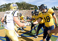 California starting captains, Kevin Riley, Chris Guarnero, Cameron Jordan and Mike Mohamed shake hands with UCLA captains after the coin toss just before the game against UCLA at Memorial Stadium in Berkeley, California on October 9th, 2010.   California defeated UCLA, 35-7.