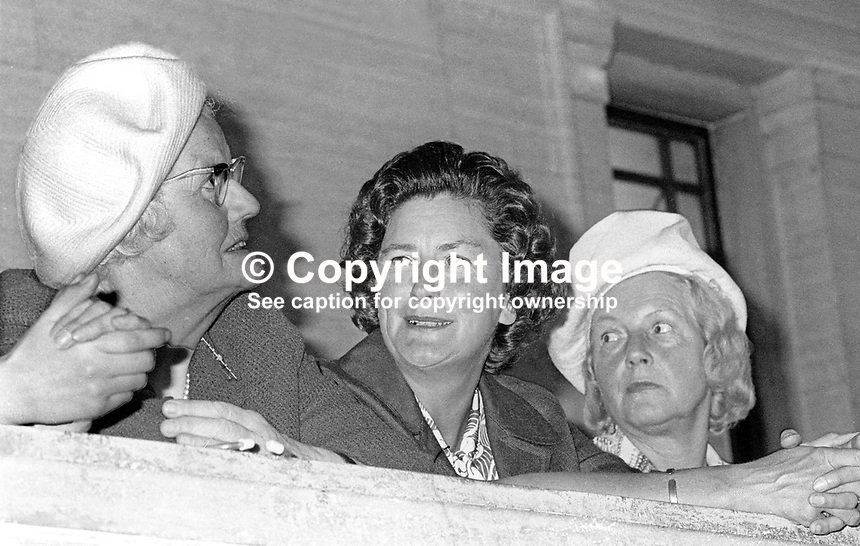 N Ireland Assembly - first meeting of the newly-elected members - 31st July 1973 - Lucy Faulkner, wife, Brian Faulkner, leader, Ulster Unionist Party, centre, has a grandstand view of the opening ceremony from a balcony of the Main Hall. 197307310523c<br /> <br /> Copyright Image from Victor Patterson, 54 Dorchester Park, Belfast, UK, BT9 6RJ<br /> <br /> t1: +44 28 9066 1296 (from Rep of Ireland 048 9066 1296)<br /> t2: +44 28 9002 2446 (from Rep of Ireland 048 9002 2446)<br /> m: +44 7802 353836<br /> <br /> e1: victorpatterson@me.com<br /> e2: victorpatterson@gmail.com<br /> <br /> The use of my copyright images is subject to my Terms &amp; Conditions.<br /> <br /> It is IMPORTANT that you familiarise yourself with them. They are available on my website at www.victorpatterson.com.<br /> <br /> None of my copyright images may be used on a website or on television unless they are visibly watermarked, i.e. &copy; Victor Patterson within the body of the visible image. The metadata of images used on the Internet must not be removed.<br /> <br /> Copyright acknowledgment of my images is a condition of use.<br /> <br /> Failure to observe the above conditions will incur a penalty of at least 100% of the agreed fee. <br /> <br /> Web use (maximum size - 400 kb) is extra at currently recommended NUJ rates.