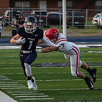 Greenwood's Caden Brown is forced out of bounds by Fort Smith Northside's Stenson Van Matre in the first quarter of Friday's game in Greenwood.