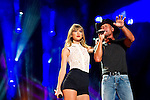 Tim McGraw performs with Taylor Swift at LP Field during Day 1 of the 2013 CMA Music Festival in Nashville, Tennessee.