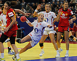 BELGRADE, SERBIA - DECEMBER 16: Heidi Loke (R) of Norway jump to scores past Milena Knezevic of Montenegro (L) during the Women's European Handball Championship 2012 gold medal match between Norway and Montenegro at Arena Hall on December 16, 2012 in Belgrade, Serbia. (Photo by Srdjan Stevanovic/Getty Images)