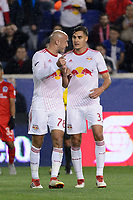 Harrison, NJ - Thursday March 01, 2018: Aurélien Collin, Aaron Long. The New York Red Bulls defeated C.D. Olimpia 2-0 (3-1 on aggregate) during a 2018 CONCACAF Champions League Round of 16 match at Red Bull Arena.