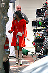.May 10th 2012 ..Lea Michele wearing a red winter coat white purse &long knee high socks smiling laughing hugging while .Filming the tv  show Glee in Los Angeles ..AbilityFilms@yahoo.com.805-427-3519.www.AbilityFilms.com..