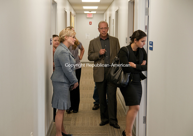 TORRINGTON, CT - 30 OCT 2014 -- Mayor Elinor C. Carbone, left, Bob Phelan, center and Krystal Rich, right, take a tour of Charlotte Hungerford Hospital's Center for Youth and Families, which opened Thursday on Litchfield Street in Torrington. Alec Johnson/ Republican-American