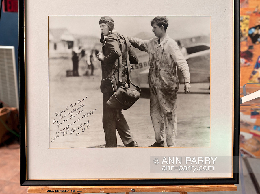"Erik Lindbergh, grandson of aviator Charles Lindbergh, participates in 85th anniversary celebration of his grandfather's historic solo flight across Atlantic, on Saturday May 19, 2012, at Cradle of Aviation museum, Long Island, New York. Autographed photo of Lindbergh, taken while he was readying for that flight, has dedication: ""George C. Dade, President of Long Island Early Fliers Club, Glen Head, Long Island. in memory of a reunion after 50 years, 1973."" Significance of the 1927 flight of C. Lindbergh's Spirit of St. Louis which started at nearby Roosevelt Field, and ended at Le Bourget, France - was discussed, along with future of aviation, by panelists Larry Williams, Erik Lindbergh, Martha King and John King; plus, plaque commemorating the flight was rededicated. 10th anniversary of Cradle of Aviation opening and 35th anniversary of Charles A & Anne Morrow Lindbergh Foundation were also celebrated."