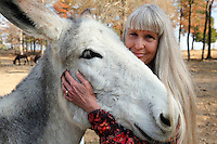 Deb Kidwell with Lake Nowhere Eden, an American Mammoth Jackstock, on Saturday, Nov. 20, 2010 at Lake Nowhere Mule and Donkey Farm in Martin, Tenn. Kidwell breeds American Mammoth Jackstock, the only American breed of Ass, and one started by George Washington. With only an estimated 2,000 left in existence, the breed is dying off with the mechanization of farm equipment.