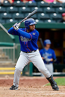 Wilin Rosario (20) of the Tulsa Drillers at bat during a game against Springfield Cardinals at Hammons Field on June 27, 2011 in Springfield, Missouri. (David Welker / Four Seam Images)