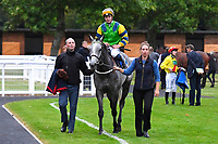 Winner of The St Christopher's Car Sales Bournemouth Supporting Gift Of Sight Handicap, Giving Back ridden by David Probert and trained by Alan King is led into the Winner's enclosure during Evening Racing at Salisbury Racecourse on 3rd September 2019