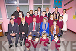 Retirement: John Clifford retires from teaching after 38 years, the last 11 of which he has spent teaching in Valentia Primary School, pictured here with his family, students, teaching staff and board of management, front l-r; Ben Egan, Donncha Lyne, Fiona?in Healy, Ro?ise Cusack, seated; John Daly(Principal), Mary & John Clifford, daughters Julie & Jackie Clifford, 3rd row; Chris O'Connor-O'Driscoll, Ashling Quigley, Chloe Lyne, Garreth Weigt, Cillian Houlihan, Sophie Egan, Aneurin Harvey, back l-r; Fr John Shanahan, Loretto Jynch, Bernadette O'Driscoll, Maeve Quirke, Sharon Musgrave & Susan Daly.