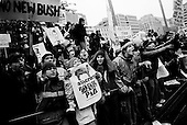 Washington DC<br /> January 20, 2001<br /> <br /> Protesters demonstrate against the inauguration of US President George W Bush at Freedom Square as the Bush's motorcade passes.