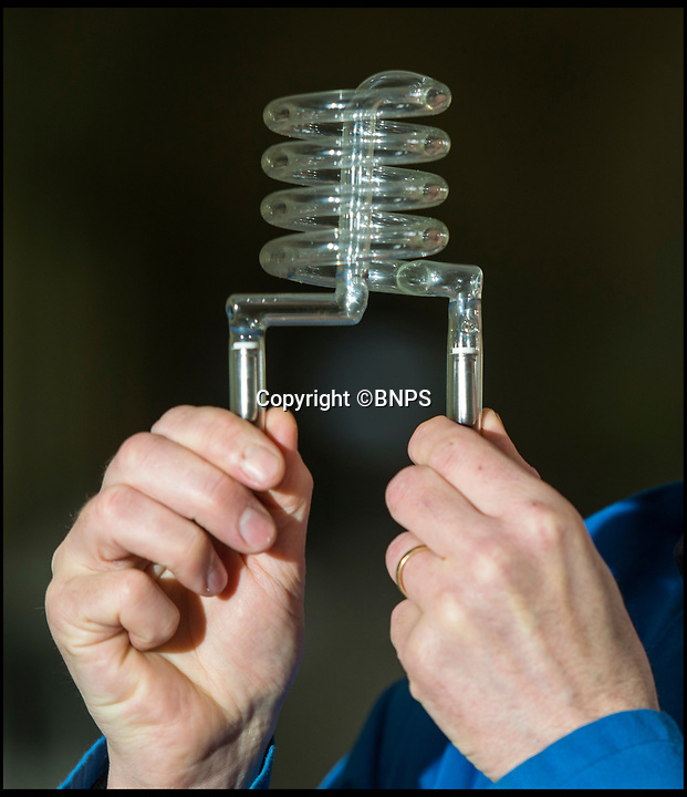 BNPS.co.uk (01202 558833)<br /> Pic: TomWren/BNPS<br /> <br /> One of the fragile lightbulbs for the navigation lights which warn aircraft of the tip of the spire.<br /> <br /> How many men does it take to change a lightbulb... at the top of Britain's tallest spire.<br /> <br /> When your office is Salisbury Cathedral the simple task of changing a light bulb involves four men, a 404ft climb and takes three hours.<br /> <br /> Ecclesiastical carpenter Richard Pike needed a head for heights when he joined Gary Price, who is in charge of conservation, to make the daring ascent with two rope specialists to ensure their safety. <br /> <br /> Despite working at the cathedral for 27 years, it was the first time Richard has ever made the hair-raising climb.