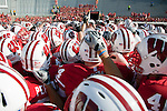 The Wisconsin Badgers football team huddles prior to an NCAA college football game against the Minnesota Golden Gophers on October 9, 2010 at Camp Randall Stadium in Madison, Wisconsin. The Badgers beat the Golden Gophers 41-23. (Photo by David Stluka)