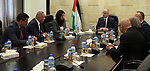 Palestinian Prime Minister, Rami Hamdallah, meets Minister of Justice Ali Abu Diak at his office, in the West Bank city of Ramallah on August 20, 2017. Photo by Prime Minister Office