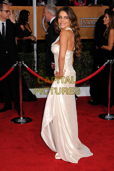 Sofia Vergara (wearing Donna Karan Atelier).Arrivals at the 19th Annual Screen Actors Guild Awards at the Shrine Auditorium in Los Angeles, California, USA..27th January 2013.SAG SAGs full length white hand on hip silk satin one strap off the shoulder side.CAP/ADM/BP.©Byron Purvis/AdMedia/Capital Pictures