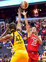 Washington, DC - June 15, 2018: Washington Mystics guard Kristi Toliver (20) shoots a hook shot over Los Angeles Sparks center Jantel Lavender (42) during game between the Washington Mystics and Los Angeles Sparks at the Capital One Arena in Washington, DC. (Photo by Phil Peters/Media Images International)