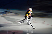 Boston Bruins goalie Tim Thomas enters the arena at the RBC Center for the Honda Superskills Competition, 1/29/2011.