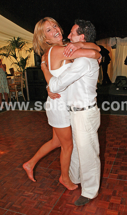 **ALL ROUND PICTURES FROM SOLARPIX.COM**.**WORLDWIDE SYNDICATION RIGHTS**.Penny Lancaster and Brendan Cole dance together at at The Duke of Essex Polo Trophy listings at Gaynes Park Estate, Epping in Essex after Penny won a dance with the Come Dancing star in a raffle.JOB REF: 4231    SSD     DATE: 07.07.07.**MUST CREDIT SOLARPIX.COM OR DOUBLE FEE WILL BE CHARGED* *UNDER NO CIRCUMSTANCES IS THIS IMAGE TO BE REPRODUCED FOR ANY ONLINE EDITION WITHOUT PRIOR PERMISSION*