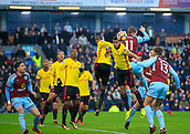 9th December 2017, Turf Moor, Burnley, England; EPL Premier League football, Burnley versus Watford; Abdoulaye Doucoure of Watford beats Chris Wood of Burnley to the header and watches as the ball goes for a corner