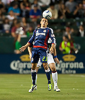 CARSON, CA – APRIL 30, 2011:  Chivas USA forward Marcos Mondaini (23) heads the ball during the match between Chivas USA and New England Revolution at the Home Depot Center, April 30, 2011 in Carson, California. Final score Chivas USA 3, New England Revolution 0.