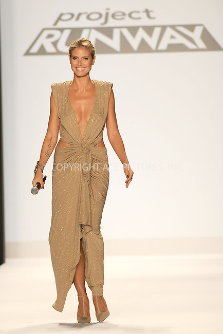 WWW.ACEPIXS.COM . . . . . .September 7, 2012...New York City.....Model Heidi Klum walks the runway at the Project Runway Spring 2013 fashion show during Mercedes-Benz Fashion Week on September 7, 2012 ...Please byline: KRISTIN CALLAHAN - ACEPIXS.COM.. . . . . . ..Ace Pictures, Inc: ..tel: (212) 243 8787 or (646) 769 0430..e-mail: info@acepixs.com..web: http://www.acepixs.com .