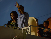 The first family, United States President Barack Obama, first lady Michelle Obama, and Malia Obama arrive at Joint Base Pearl Harbor-Hickam in Honolulu, Hawaii on December 20, 2013 for their winter vacation.<br /> Credit: Cory Lum / Pool via CNP