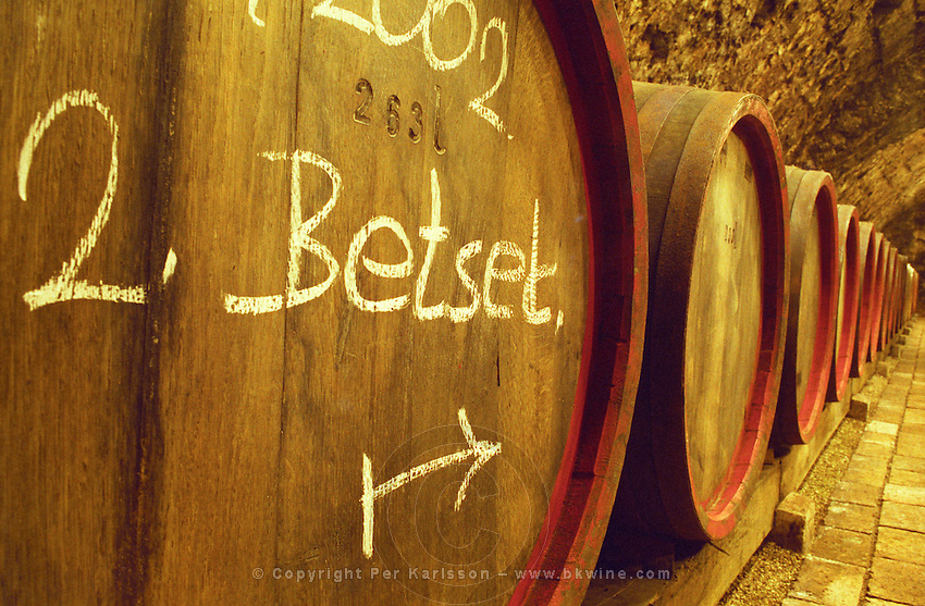 """The Kiralyudvar winery in Tarcal: in the underground cellar, rows of barrels with Tokaj wine. Marked with the vintage 2002 and Betset. Kiralyudvar (meaning """"King's Court"""")is run by Istvan Szepsy, considered maybe the best winemaker in Tokaj. he also makes Tokaj under his own name.  Credit Per Karlsson BKWine.com"""