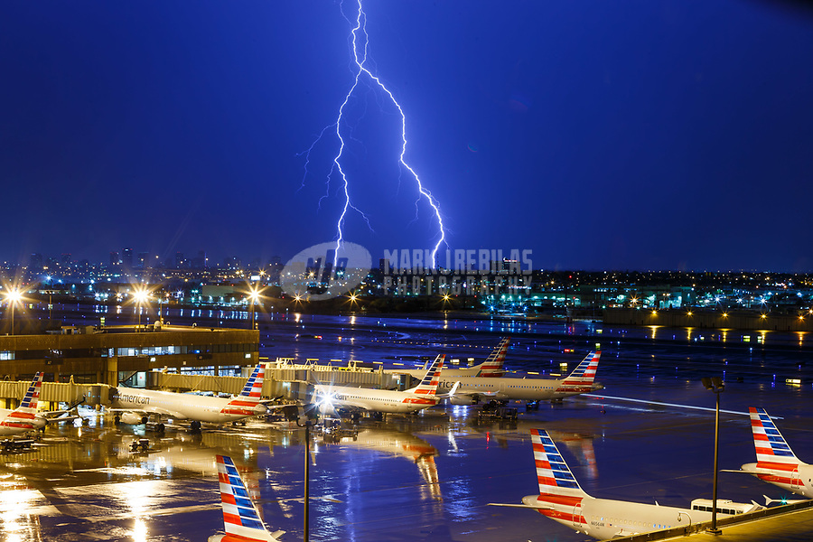 Jul 16, 2017; Phoenix, Arizona, USA; Lightning strikes near American Airlines commercial passenger jets parked at the terminal at Sky Harbor International Airport. Mandatory Credit: Mark J. Rebilas