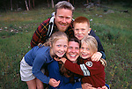 A family of five posing for an outdoor portrait in Rocky Mtn Nat'l Park, CO.