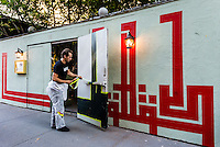 """New York, NY 18 September 2015 - French Graffiti artist L'Atlas at work on one of his """"abstract calligraphy"""" murals."""
