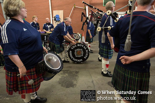 Scotland 1 Republic of Ireland 0, 14/11/2014. Celtic Park, European Championship qualifying. A pipe band dressed in football shirts assembling inside the stadium before playing the national anthems at the European Championship qualifying match between Scotland and the Republic of Ireland at Celtic Park, Glasgow. Scotland won the match by one goal to nil, scored by Shaun Maloney 16 minutes from time. The match was watched by 55,000 at Celtic Park, the venue chosen to host the match due to Hampden Park's unavailability following the 2014 Commonwealth Games. Photo by Colin McPherson.