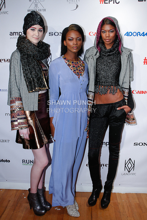 Models pose in outfits from the Abacaxi Fall Winter 2014 collection by Sheena Sood, at the Launch NYC Manufacture New York Incubator Runway Show, during New York Fashion Week on February 5, 2014.