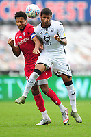 Korey Smith of Bristol City vies for possession with Rhian Brewster of Swansea City during the Sky Bet Championship match between Swansea City and Bristol City at the Liberty Stadium in Swansea, Wales, UK. Saturday 18 July 2020