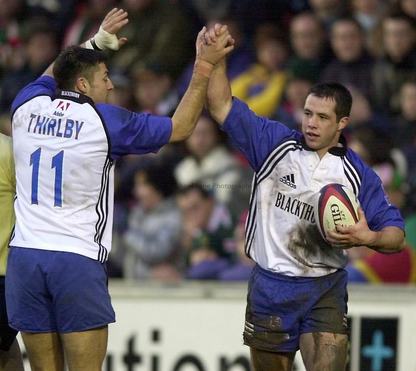 Photo. Richard Lane. .Leicester v Bath. Zurich Premiership. 16/12/2000..Gareth Cooper celebrates his try with Rob Thirlby.
