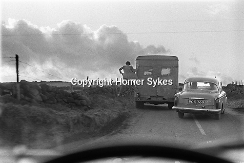 Man jumping off the back of a lorry Yorkshire<br /> <br /> My ref 00a/117/1968<br /> <br /> PARIS 2015 LES DOUCHES LA GALERIE<br /> Vintage silver gelatin print. 9x6 on 10x8 <br /> <br /> Vintage print made by Homer Sykes