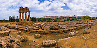 Panoramic photo at The Valley of the Temples (Valle dei Templi), Temple of Castor and Pollux, Agrigento, Sicily, Italy, Europe. This is a panoramic photo of the ruins of The Temple of Castor and Pollux at The Valley of the Temples (Valle dei Templi). Valley of the Temples (Valle de Temple) and thus The Temple of Castor and Pollux, are a UNESCO World Heritage Site on the South Coast of Sicily, Italy.