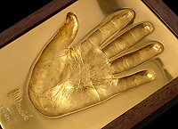 BNPS.co.uk (01202 558833)<br /> Pic: Guernseys/BNPS<br /> <br /> A set of four remarkably detailed gold casts of Nelson Mandela's hands have emerged for sale for £7.5million. ($10million)<br /> <br /> They were made out of pure gold in 2002 and initially sold to raise funds for the Nelson Mandela Children's Fund.<br /> <br /> Two of the casts show his fists, while the others are of his open palms. <br /> <br /> They show the scars of his 26 years imprisoned on Robben Island.