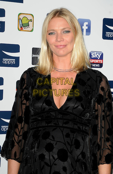 JODIE KIDD .At the Carphone Warehouse Appys Awards, Vinopolis, Stoney Street, London, England, UK, April 11th 2011..half  length black dress pregnant maternity patterned cleavage .CAP/CAN.©Can Nguyen/Capital Pictures.